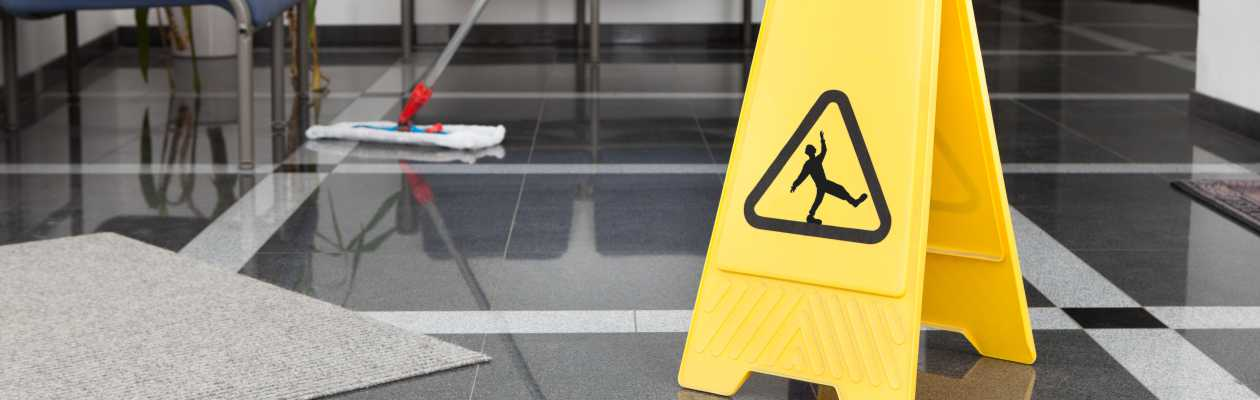 commercial cleaning chester image of a 'slip warning' sign