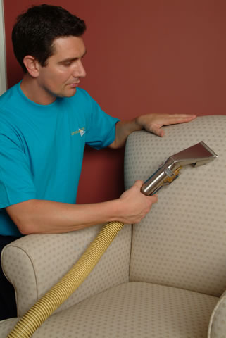 SMCleanNW | Commercial Office Cleaning Ellesmere Port | Vacuuming Sofa