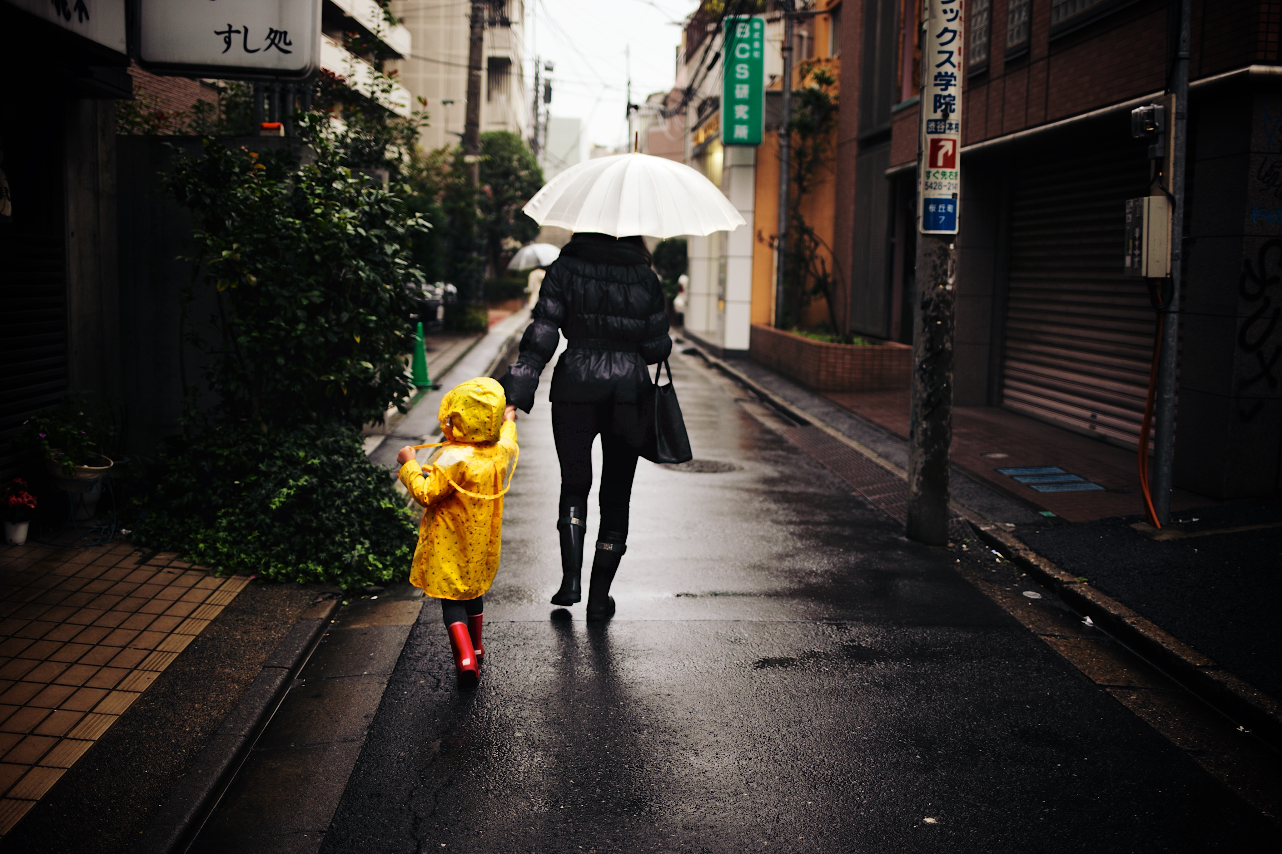 Commercial Cleaning and Office Cleaning North West | SMClean NW | Adult and Child Walking in the Rain